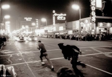 Julian Wasser, LAPD cop Chasing student on Hollywood Blvd, 1964/2012, Wentrup