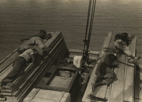 Russell Lee, Untitled, Men lying on stacks of wooden planks on boat, c. 1937 , Howard Greenberg Gallery