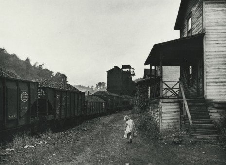 Marion Post Wolcott, Unemployed coal miner's daughter carrying home can of kerosene. Company housing, Scotts Run, W. Va., 1938, Howard Greenberg Gallery