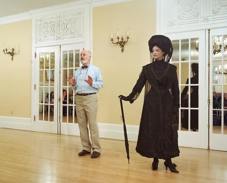 Jeff Wall, Ivan Sayers, costume historian, lectures at the University Women's Club, Vancouver, 7 December 2009. Virginia Newton-Moss wears a British ensemble c. 1910, from Sayers' collection, 2009, Marian Goodman Gallery