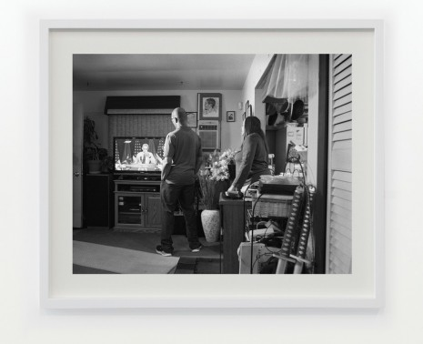 LaToya Ruby Frazier, Shea's Aunt Denise and Uncle Rodney in their home on Foster Street watching President Barack Obama take a sip of Flint water, 2016 / 2017, Gavin Brown's enterprise